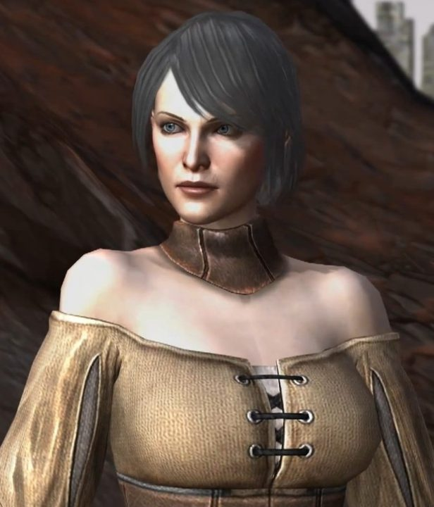 Dragon Age II artwork of Leandra Amell, a woman with short black hair and a grave expression, wearing a leather choker and low-cut linen robe.