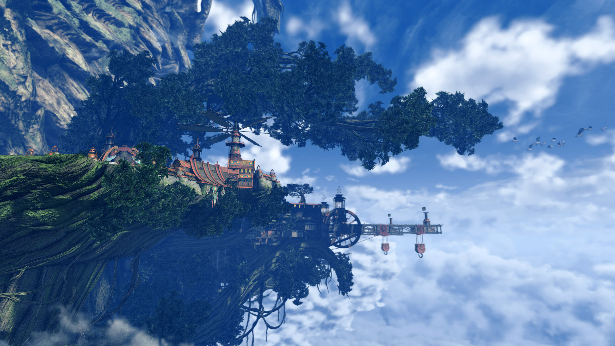 Some red-roofed buildings sit percariously under a tree high on a cliff. A crane reaches out from the building into the cloud
