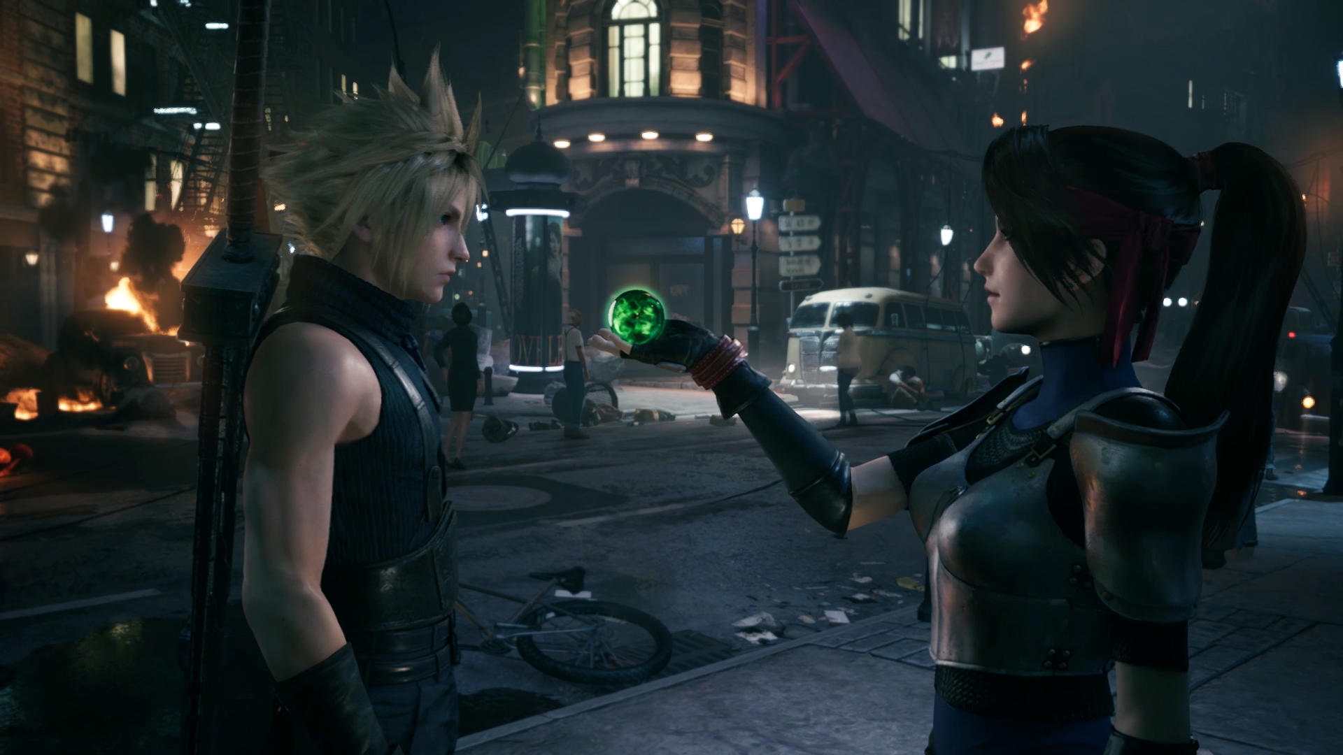 Jessie hands Cloud Strife a helpful Materia in Final Fantasy VII Remake from Square Enix.