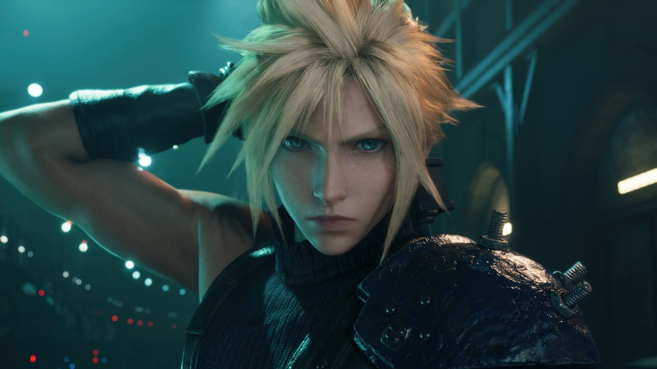 A close-up of Cloud Strife in Final Fantasy VII Remake Intergrade, Buster Sword on his back and standing inside one of the mako reactors in the city of Midgar.