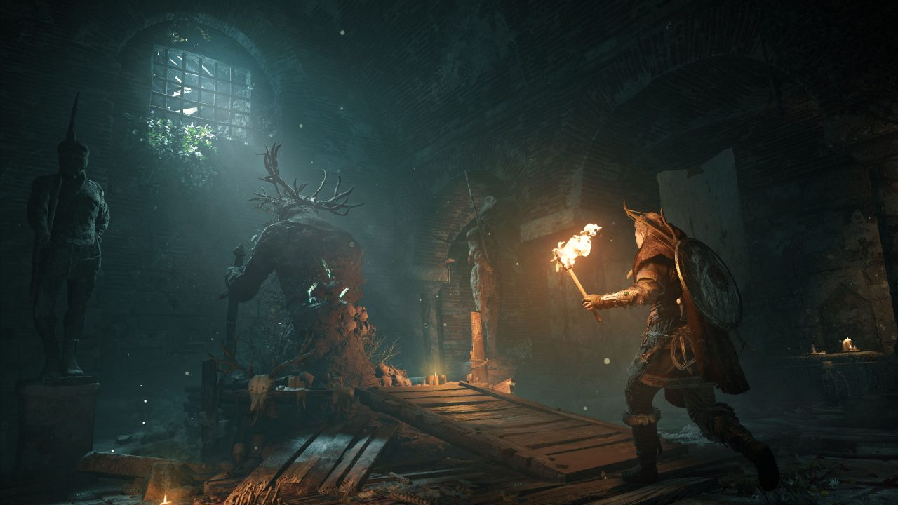 Feivor sneaks up behind a giant antlered figure, with one window casting light onto it and the pile of skulls at its feet.