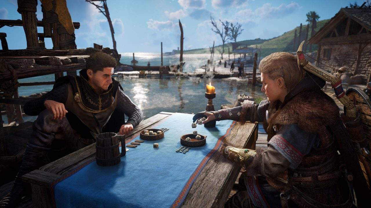 Feivor sits at an outdoor table with a blue cloth playing a dice game.