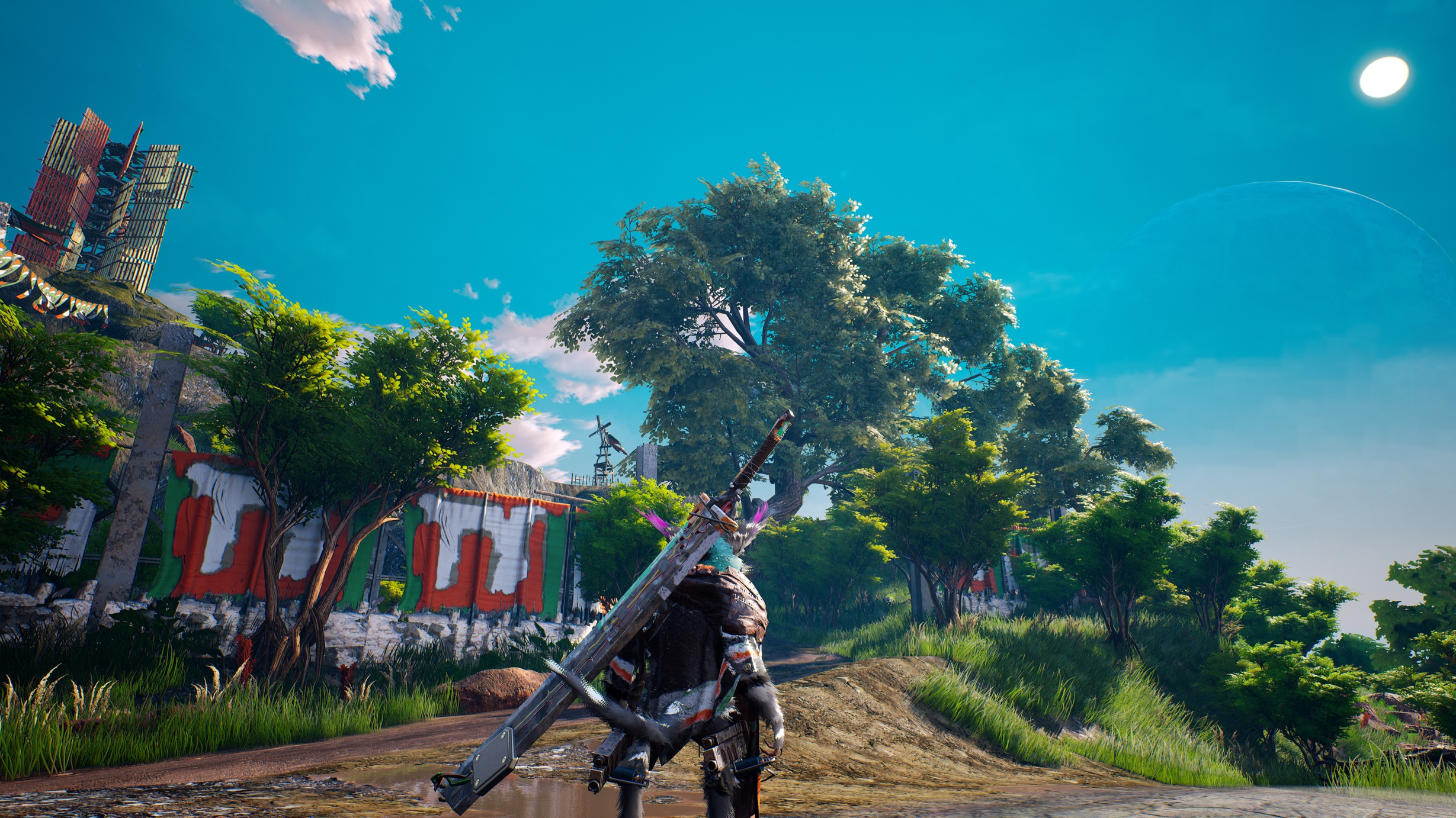 The protagonist of Biomutant looks out at a moss-laden outpost, deep in a green forest.