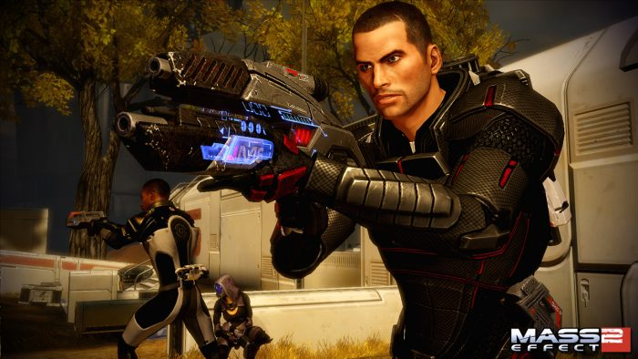 Shepard aims a glowing blue gun.