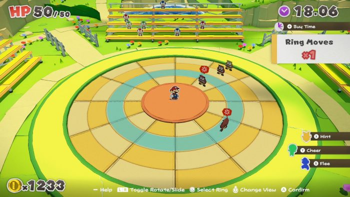 Mario faces off against some Goombas in the upper right of an orange and blue dartboard style grid.