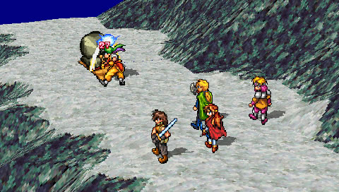 A screenshot of a battle from Suikoden with five people battling a monster on a rocky mountain path.