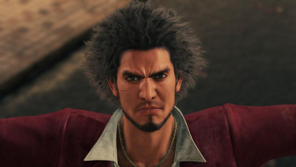 Yakuza: Like a Dragon screenshot: Ichiban glares at the camera with a cut on his cheek.
