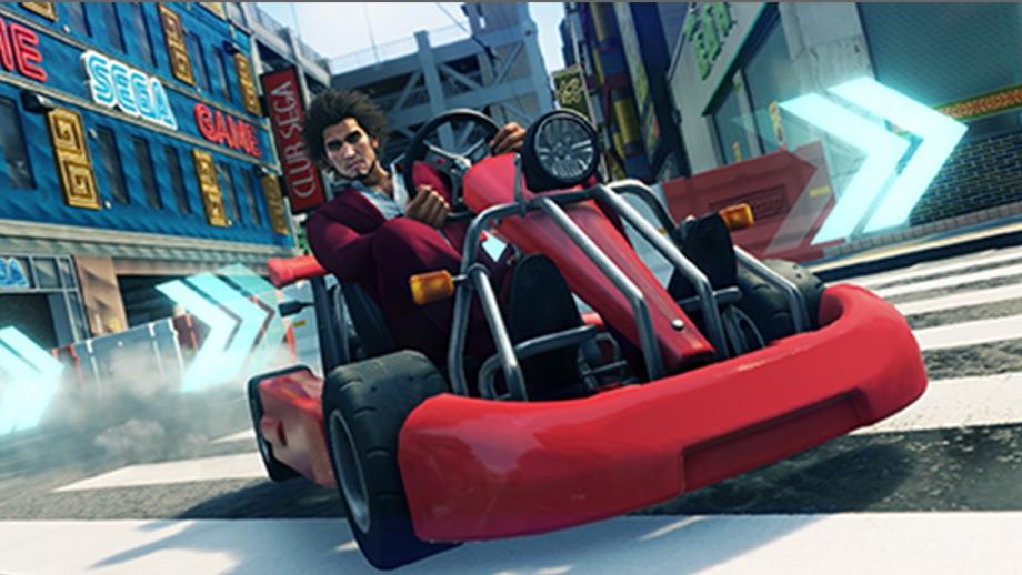 Ichiban Kasuga driving a miniature car.