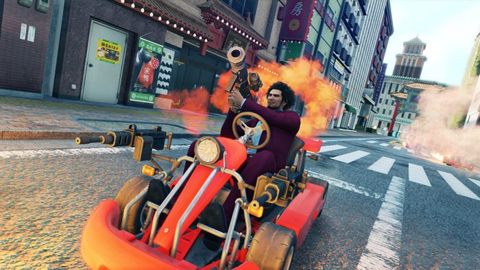 Yakuza: Like a Dragon's protagonist wielding a bazooka in a red go-kart outfitted with an automatic weapon.