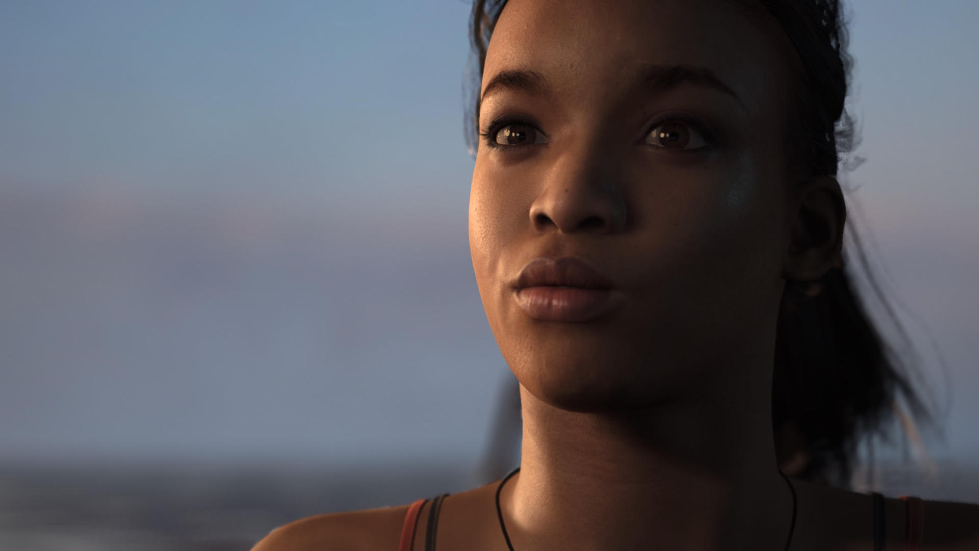 Black woman confidently looking forward with an ocean horizon behind her at sunset