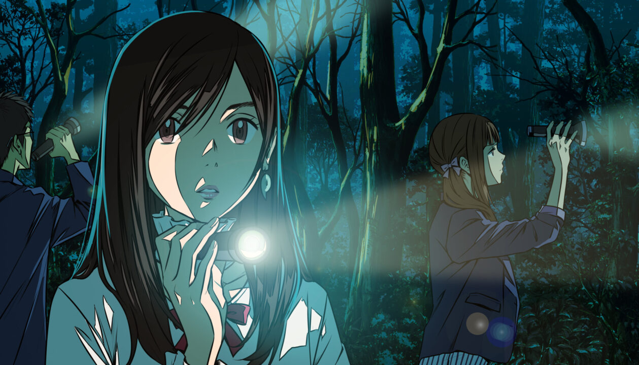 One of the protagonists of Root Film shines a flashlight to guide her way across a dreary forest.