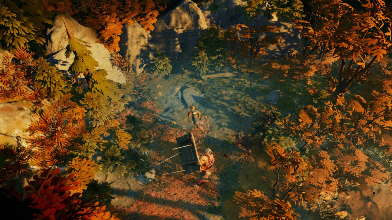 Iron Danger screenshot of Kipuna and Topi exploring some old stone ruins in a forest of reddish leaves.
