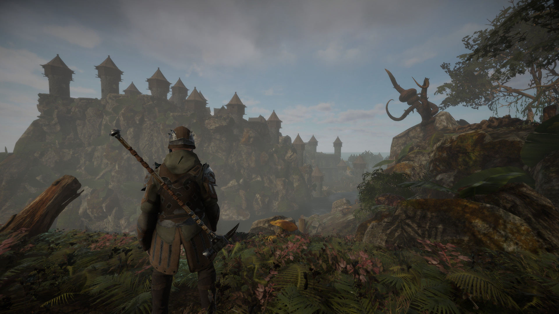 The player character, dressed in armor and wielding a sword, looks out upon the vast landscape in Isles of Adalar.