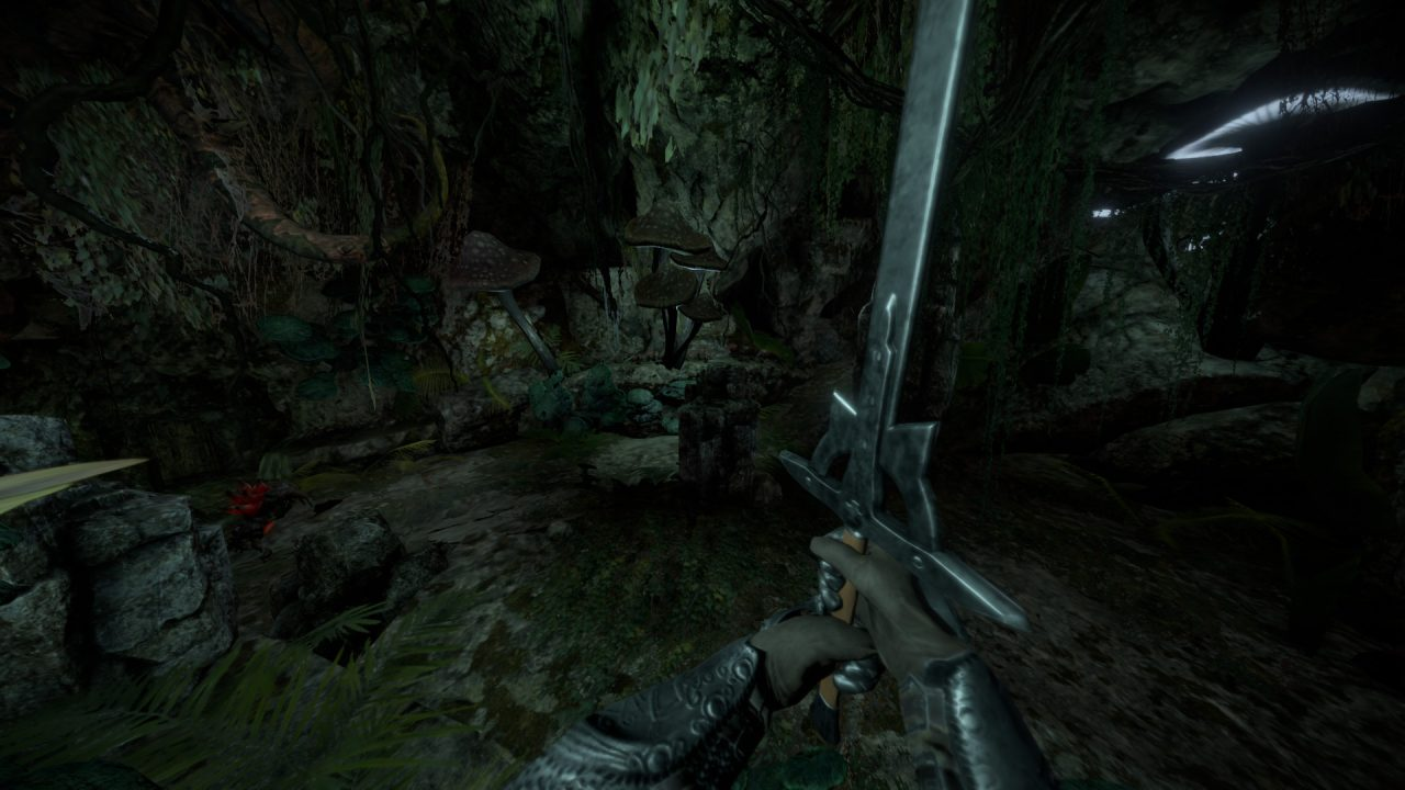 The player wields a mighty sword in a dank cavern in Isles of Adalar.
