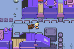 Just Lucas and his dog walking along in an industrial-looking area in this Mother 3 screenshot.