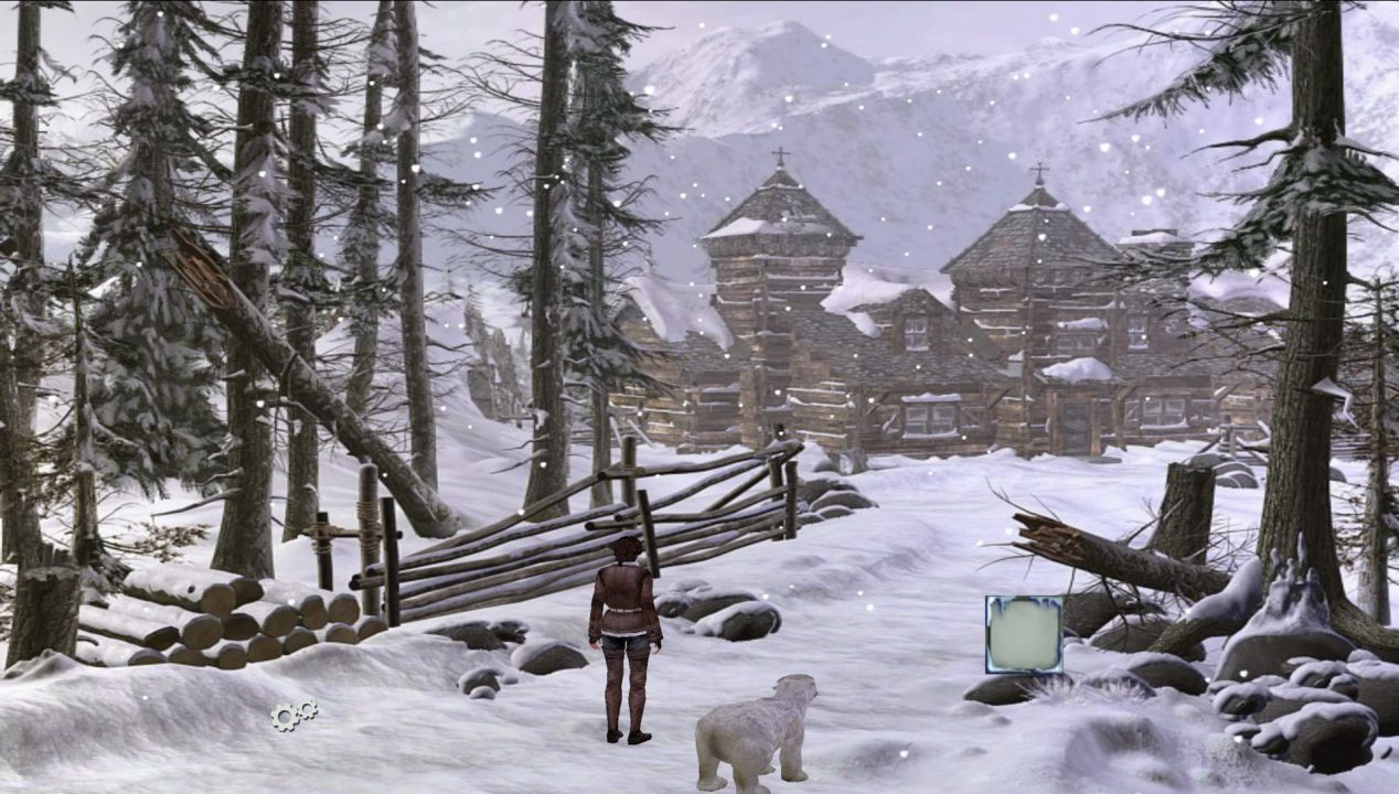 Syberia screenshot of a woman in a snow-covered landscape with a rustic lodge in the near distance.