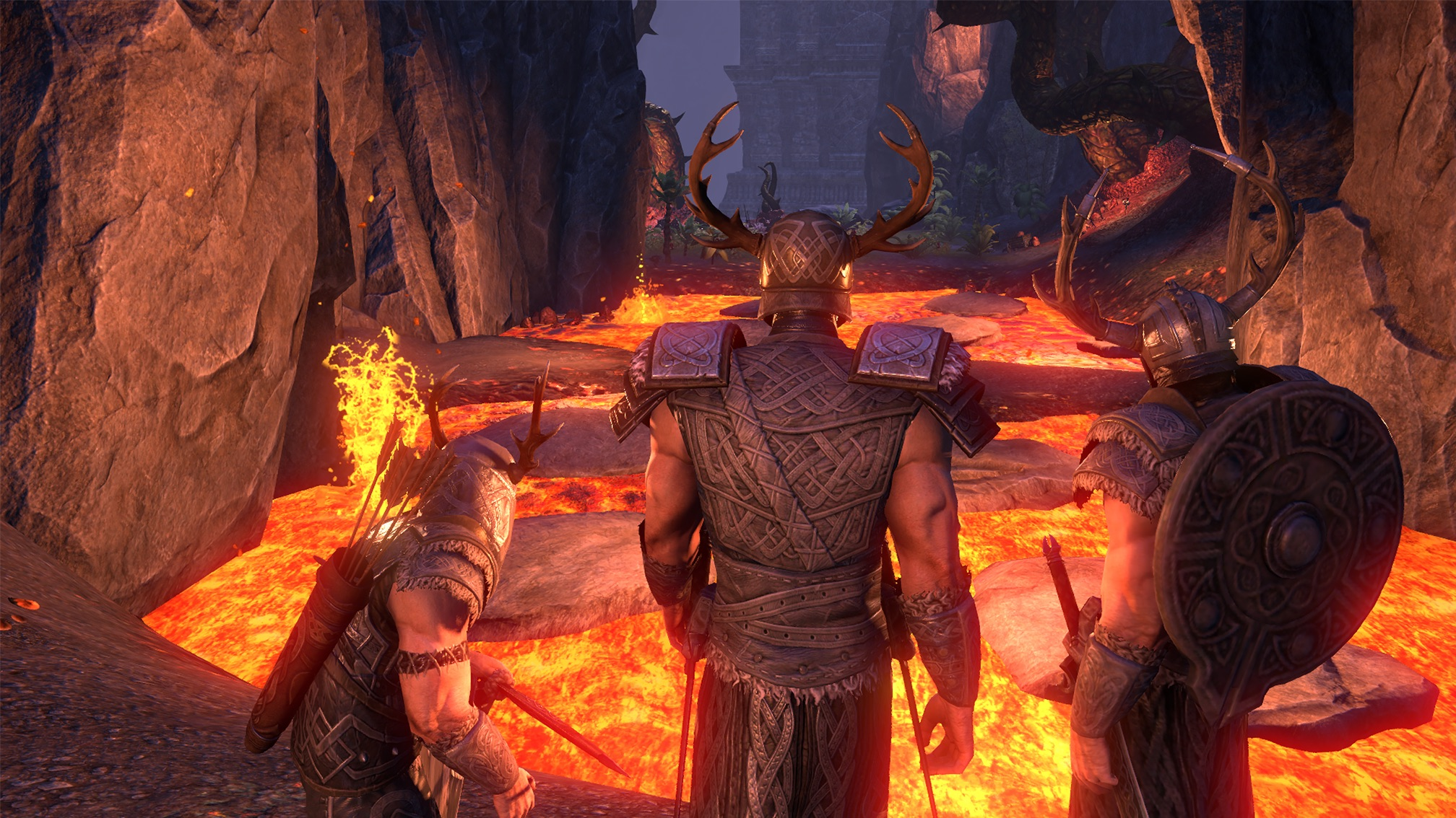 A fiery Oblivion Gate realm in The Elder Scrolls Online: Blackwood. There are three male characters on screen with their backs facing the camera. One has a shield on their back, one has a quiver of arrows, and the middle has antlers on their head.