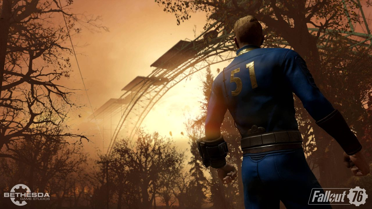 Fallout 76 Screenshot of a man looking up at scaffolding of a bridge over a forest of dead trees at sunset