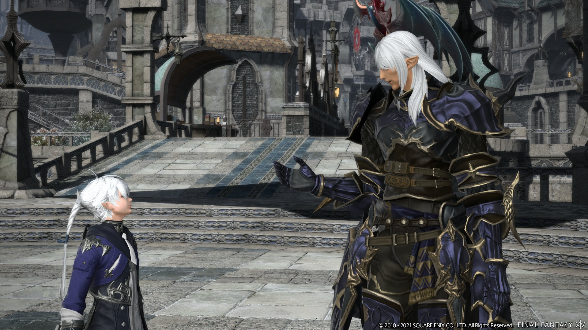 Two elf-like men, called Elezen, stand talking to each other. On the left is Alphinaud Leveilleur, dressed in blue robes with white hair tied back in a braided ponytail. On the right is Estinien Wyrmblood, the former Azure Dragoon, with long white flowing locks and donning dark dragoon armor.
