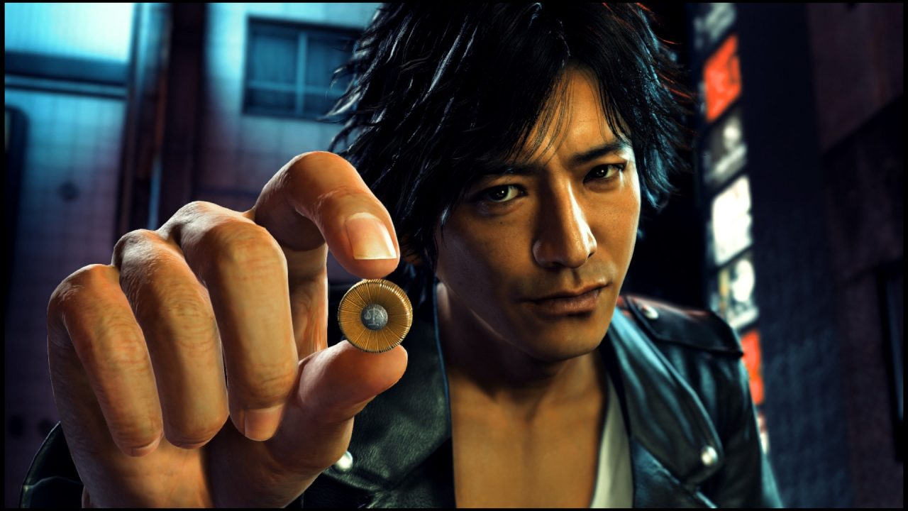 Judgment Screenshot of dark-haired Japanese man holding a bullet up to the viewer.
