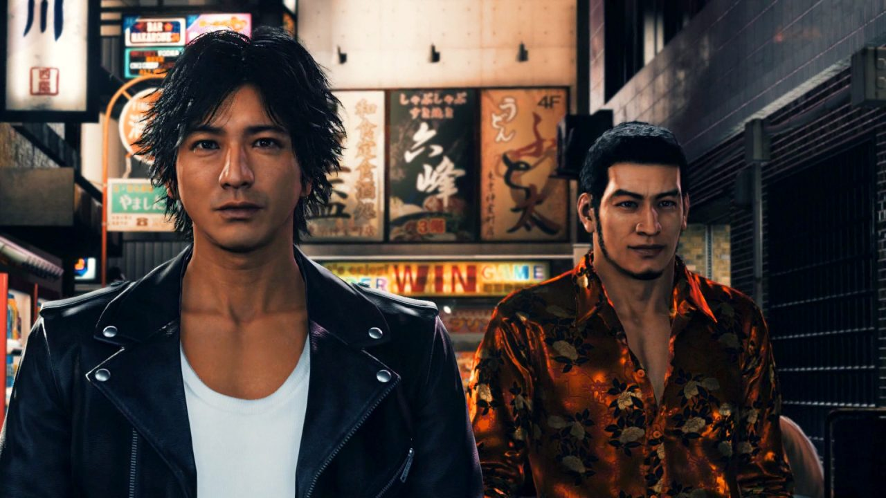 Judgment screenshot featuring Yagami and colleague roaming the streets of Kamurocho.