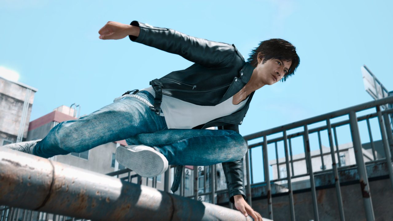 Screenshot of Yagami stylishly leaping over a large pipe with the skyline behind him.