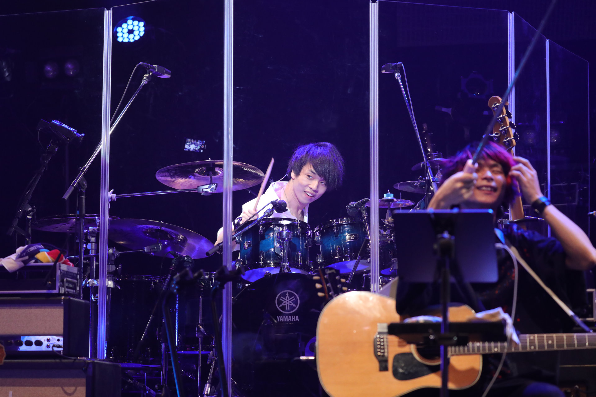 Chrono Cross concert photo of a guitarist and drummer performing.