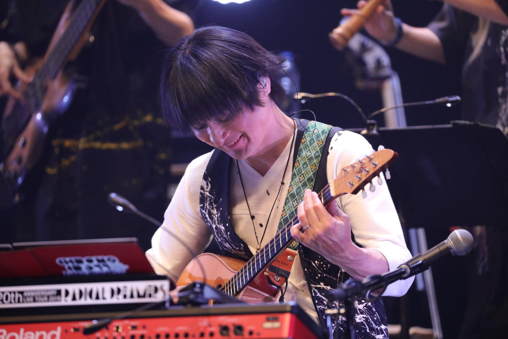 Yasunori Mitsuda playing guitar at the Chrono Cross concert.