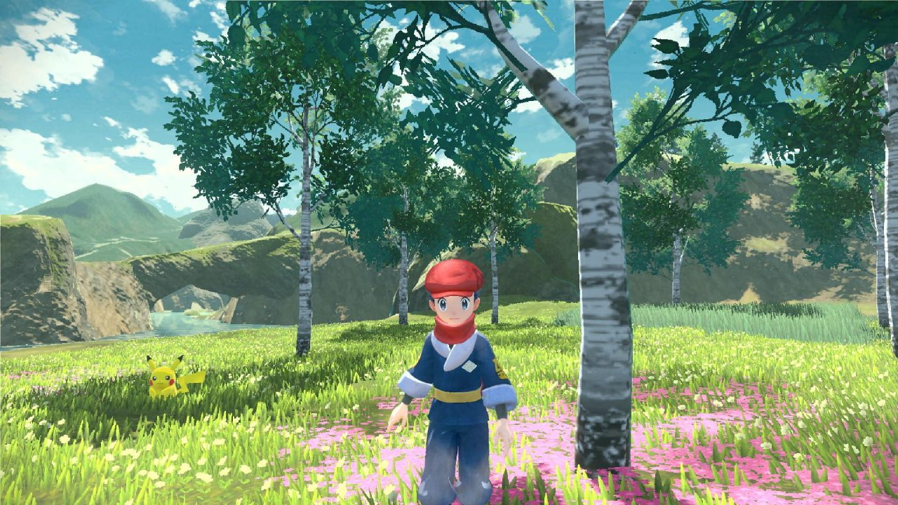 Trainer in the forest with Pikachu, near a white-barked tree and some pink flowers.