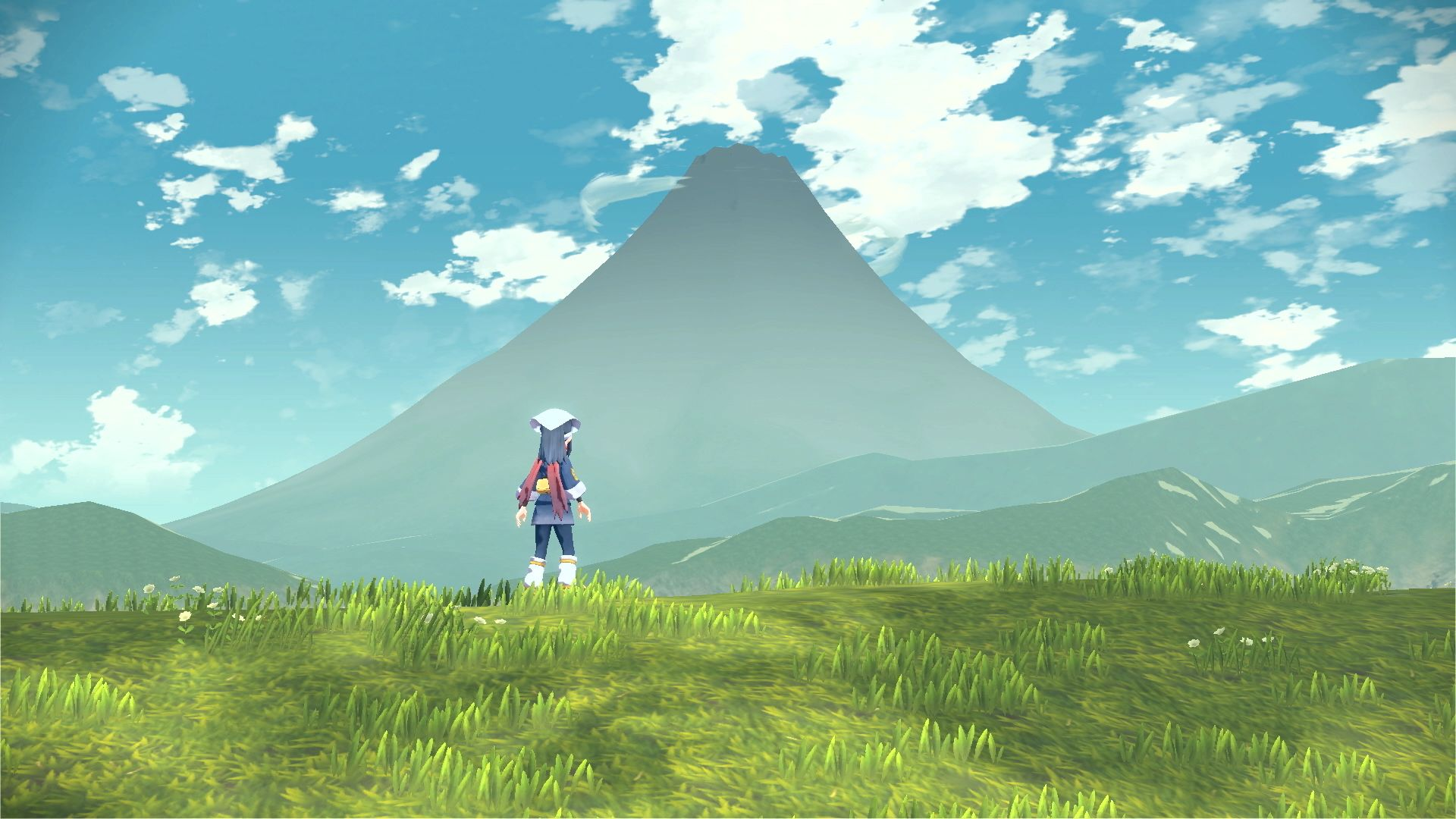 The player gazes upon a distant mountain in Pokemon Legends Arceus.