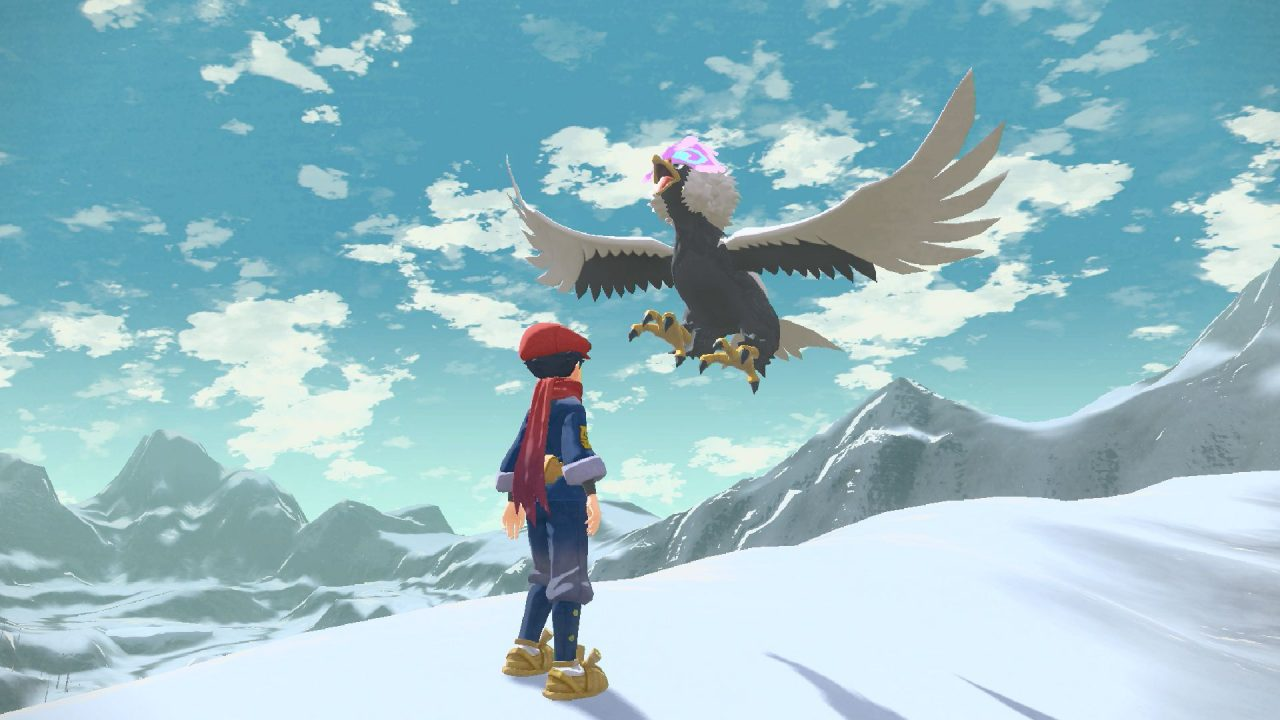 Pokémon Legends Arceus Screenshot of the player character encountering a majestic Hisuian Braviary in a snowy mountain range.