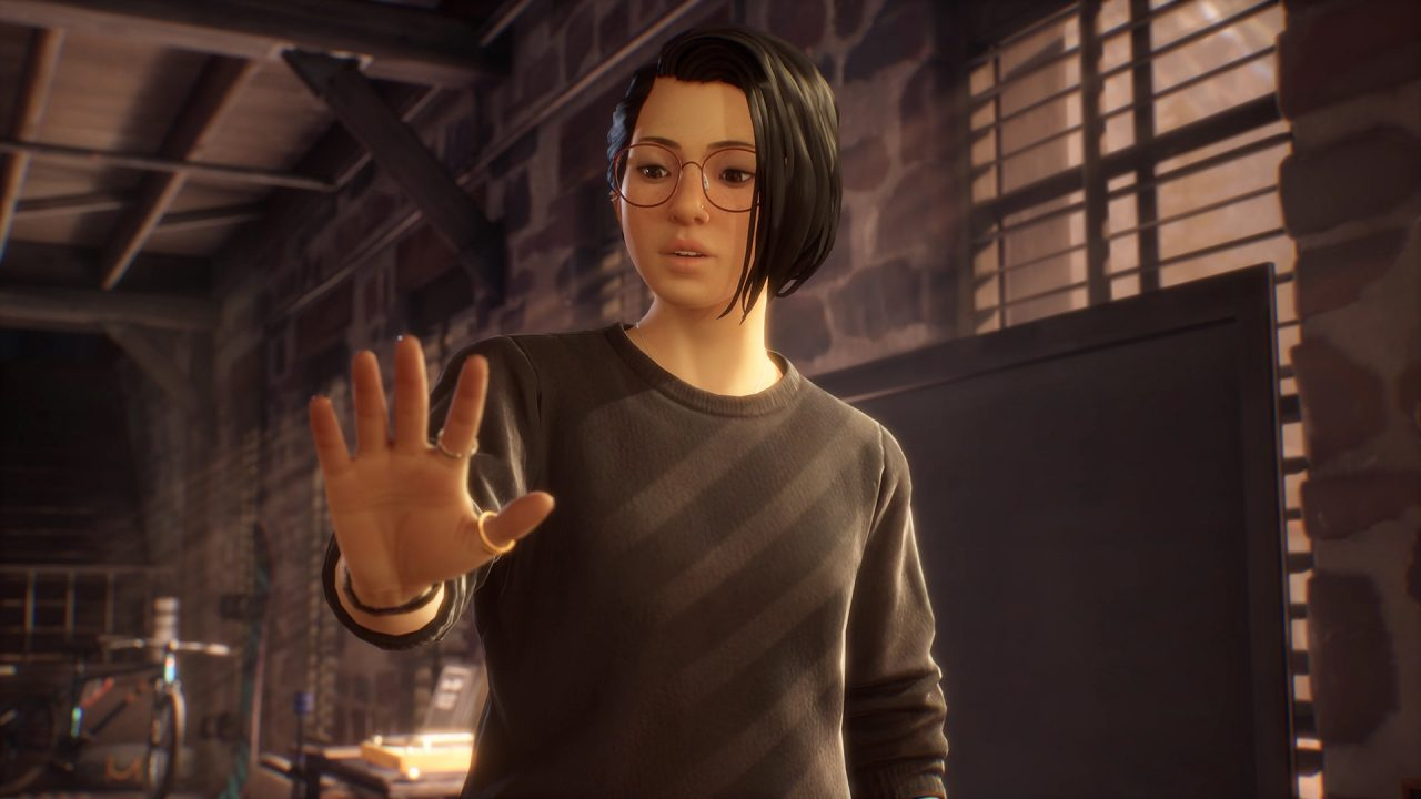 Alex Chen, the heroine of Life is Strange: True Colors, looks at her hand as she discovers her powers.