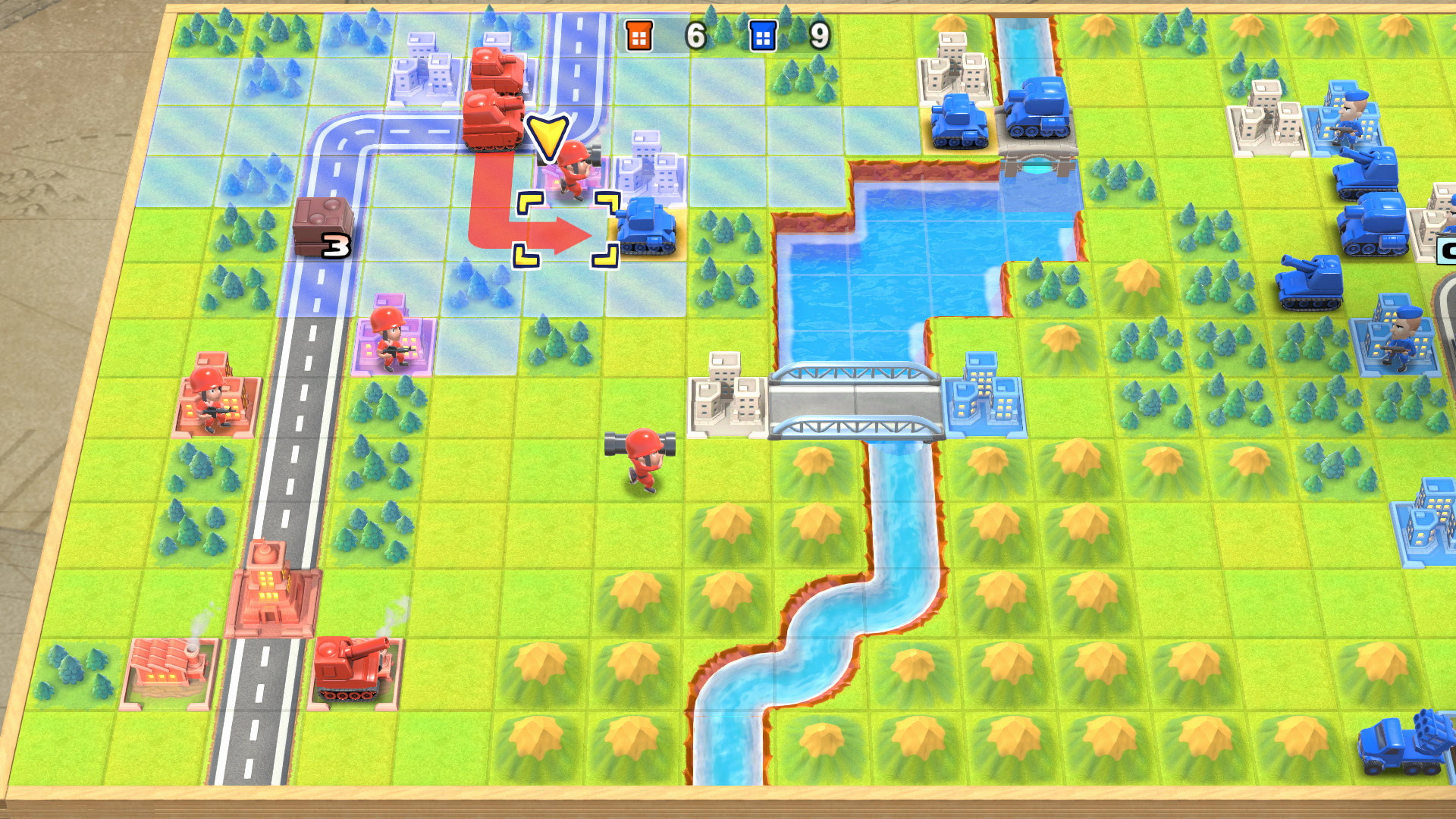 Advance Wars 1+2 Re-Boot Camp Screenshot of a top-down view on a cartoony grid-based battlefield dotted with a river, mountains, and trees.