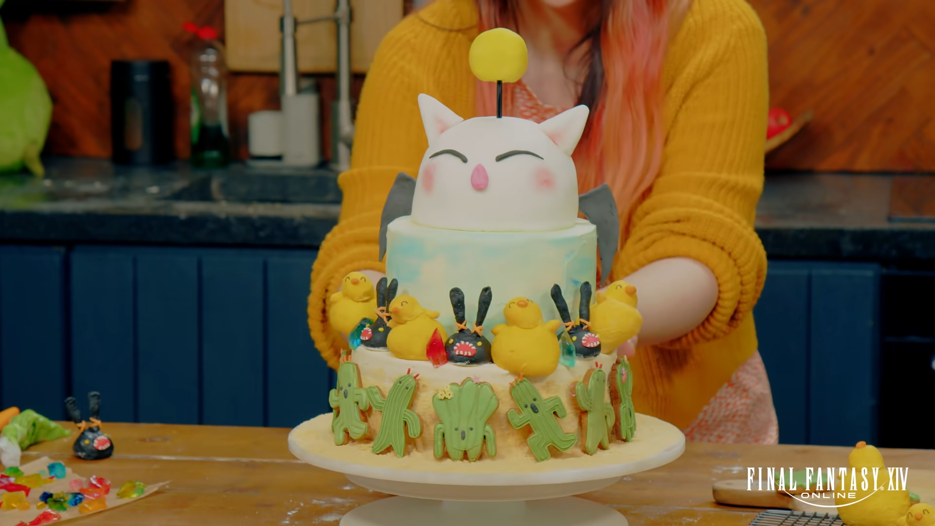 Final Fantssy XIV cake featuring Spriggans, Cactuars, Chocobos, and a moogle.
