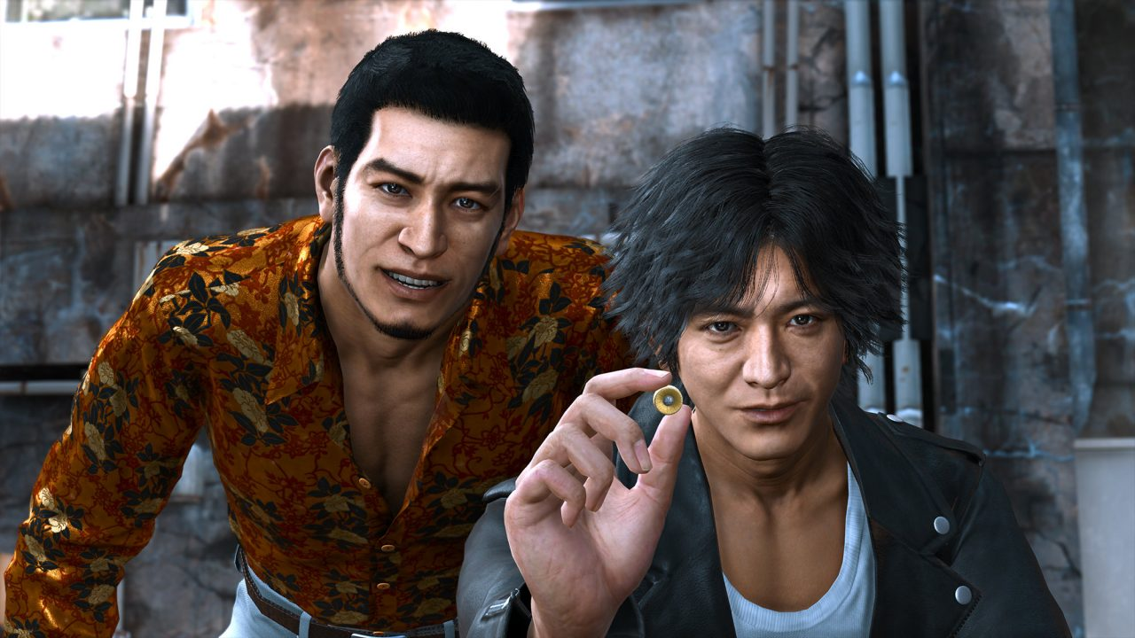 Lost Judgment screenshot of Yagami and Kaito, the former holding a golden attorney's badge.