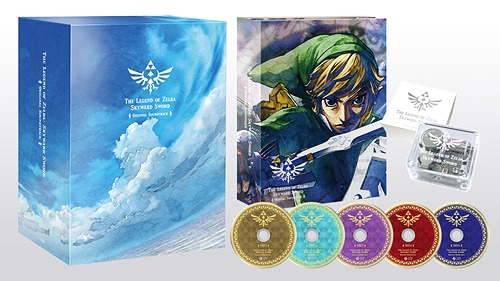 The Legend of Zelda: Skyward Sword Soundtrack Limited Edition Box next to its contents of an inner slipcase with artwork of Link, a music box, and five different colored CDs.