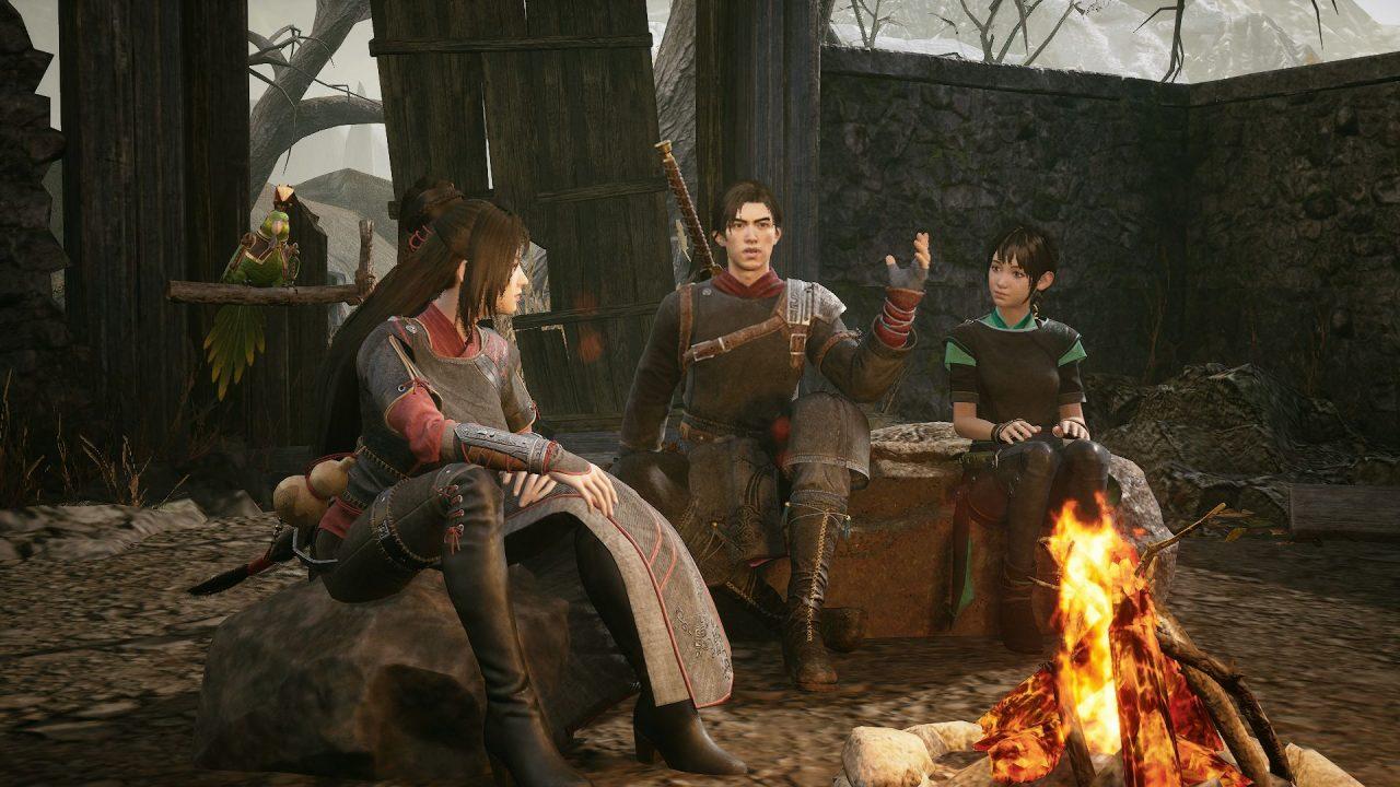 Zhao, Xiang, and Hong sit around a campfire in Xuan Yuan Sword 7